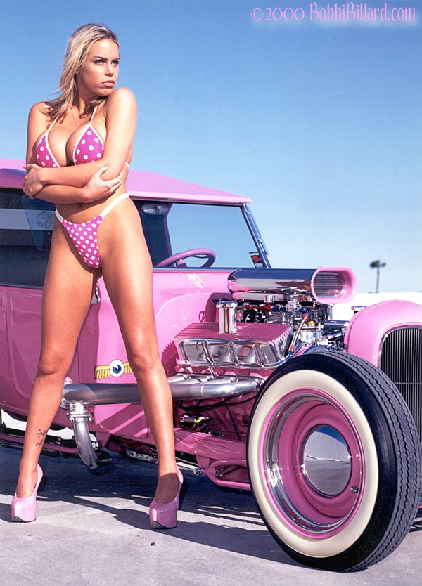 pink hot rod with a pink swimsuit model